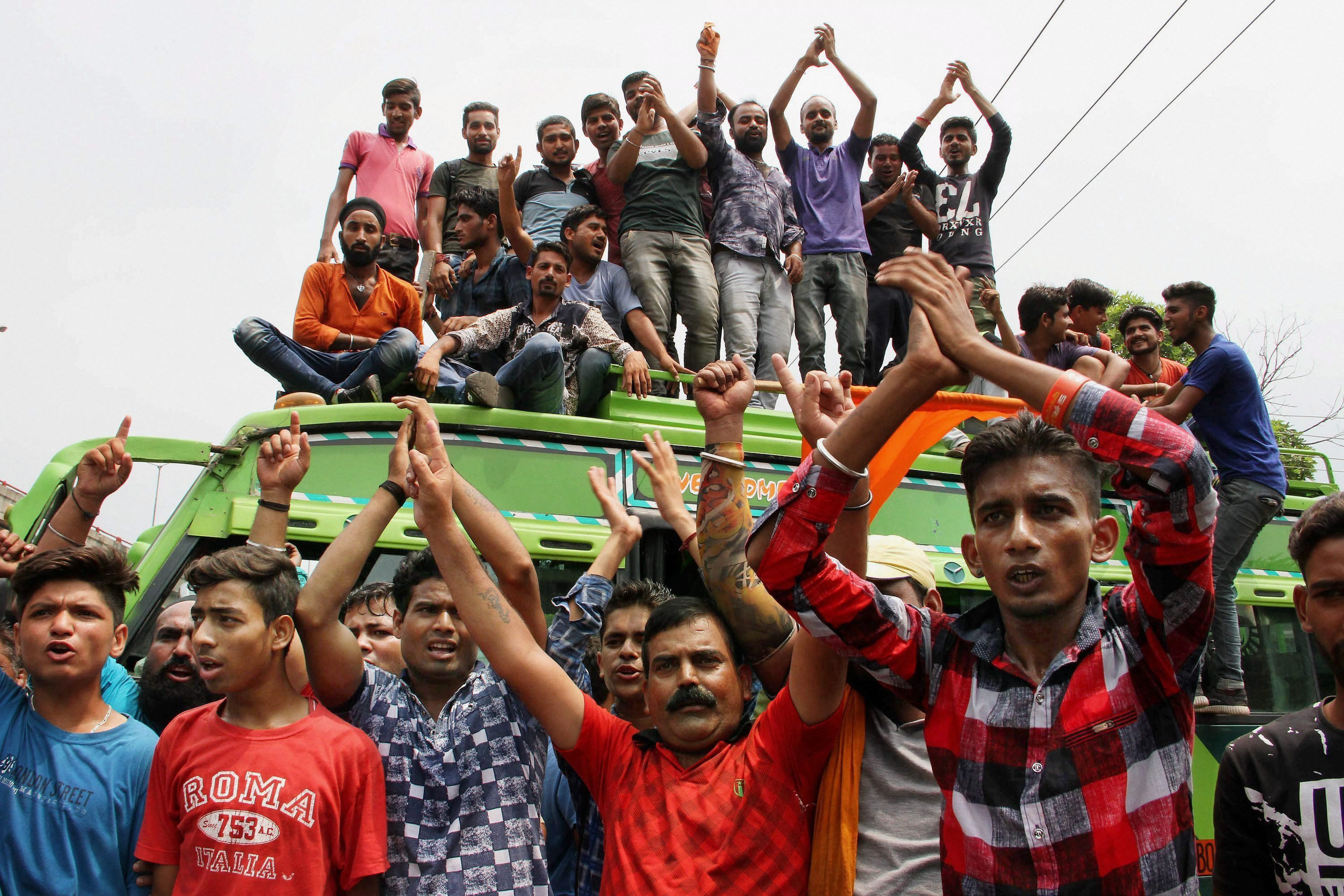 Protestors should slogans during a strike in Jammu. (Credit: PTI)