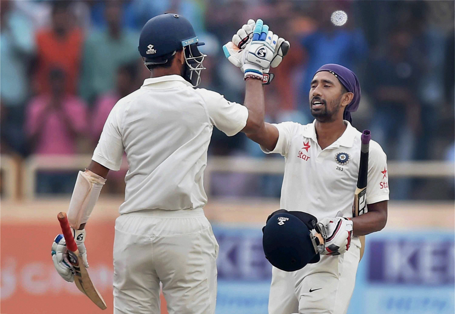 Saha and Pujara paced their partnership perfectly. Image credit: PTI