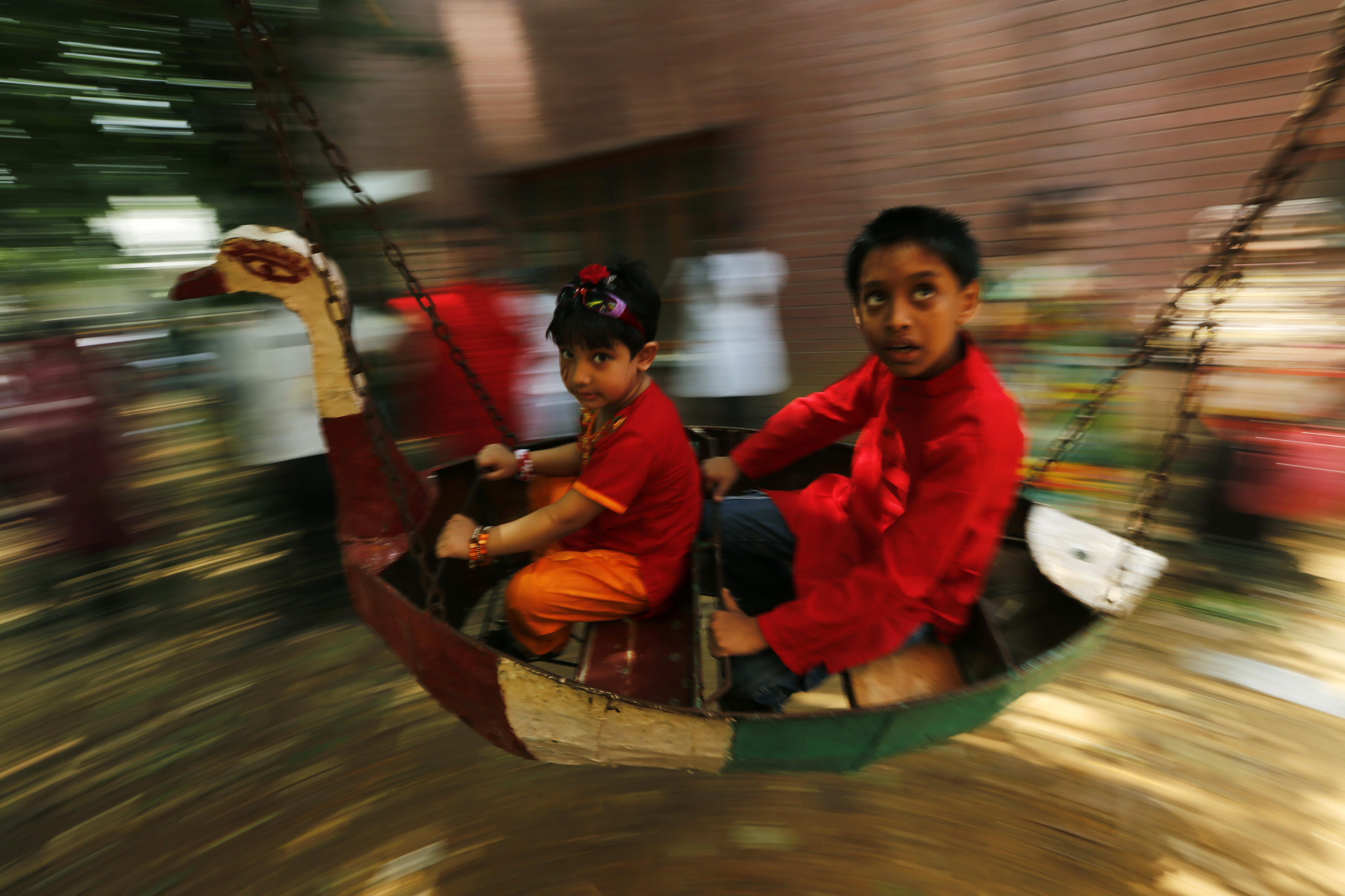 Children at play during the Mongol Shobhajatra in Dhaka. Photo credit: REUTERS/Andrew Biraj