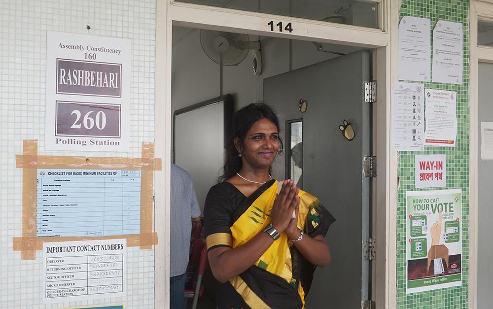 Riya Sarkar, a transwoman, was the presiding officer at a polling booth in Kolkata during the state elections. Credit: Dibyangshu Sarkar/AFP
