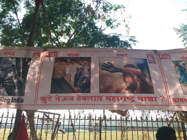 Posters mocking the central government's Swachh Bharat Abhiyan at the rally.