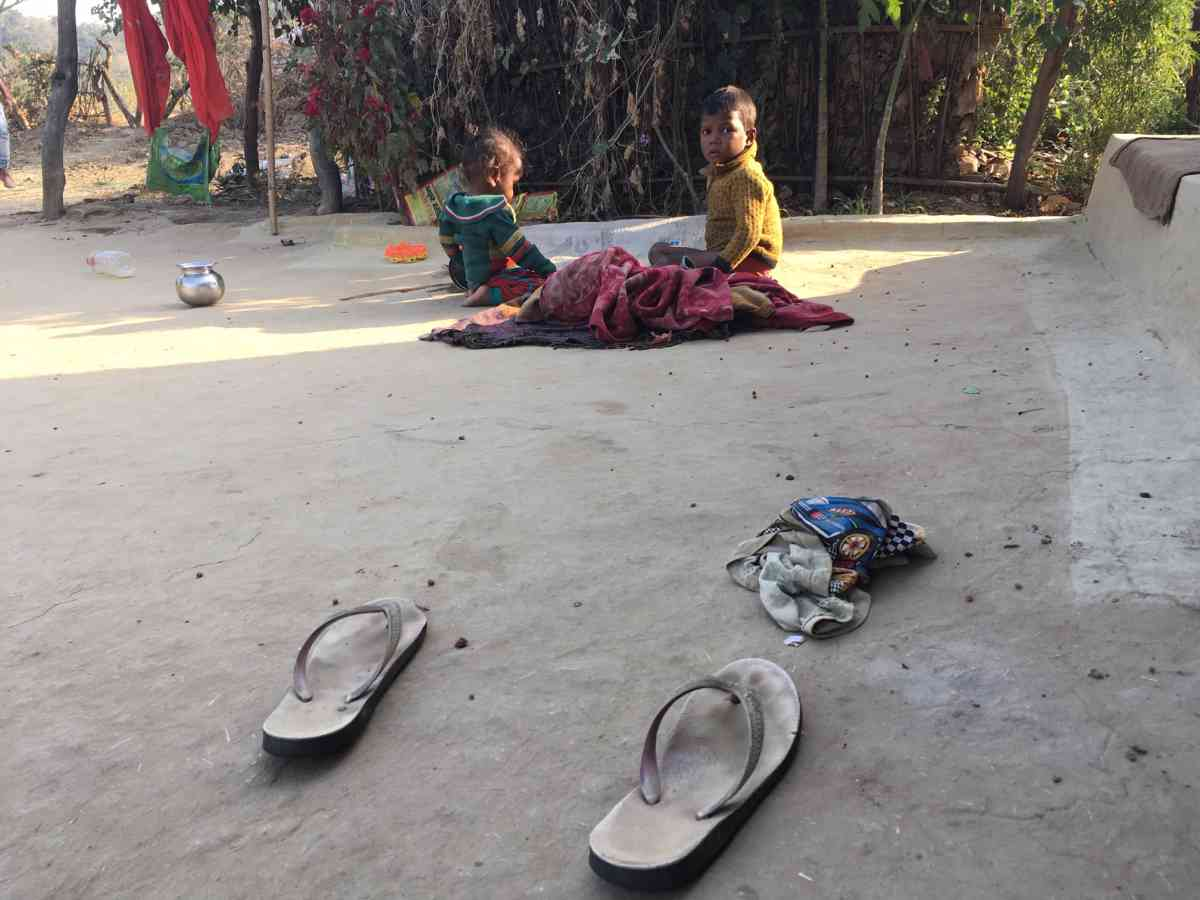 Children play outside a house in Khilora village in Chitrakoot.
