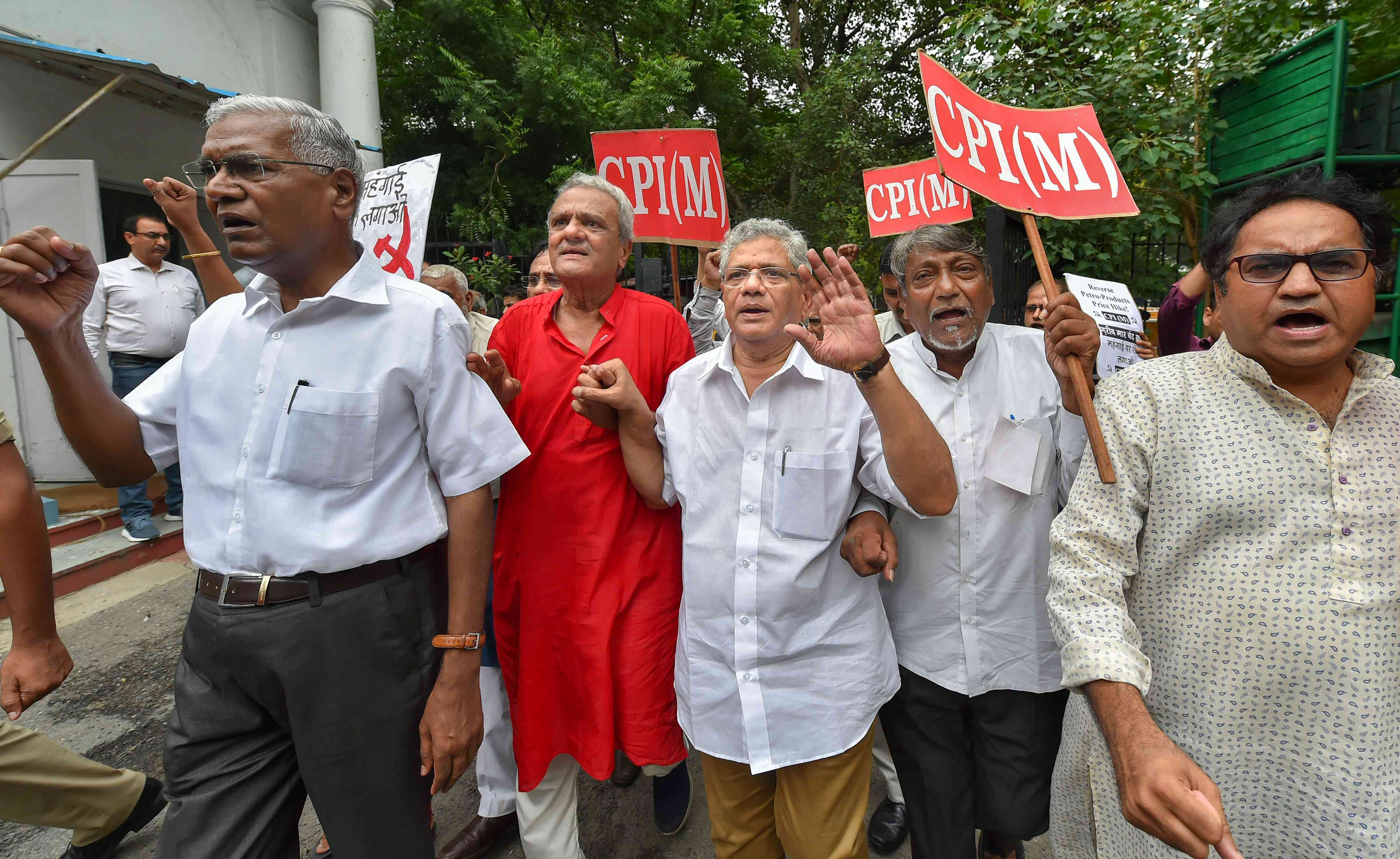 CPI(M) General Secretary Sitaram Yechury (centre), CPI leader D Raja (left) and other Left leaders at a rally in New Delhi on Monday afternoon. (Photo: PTI)