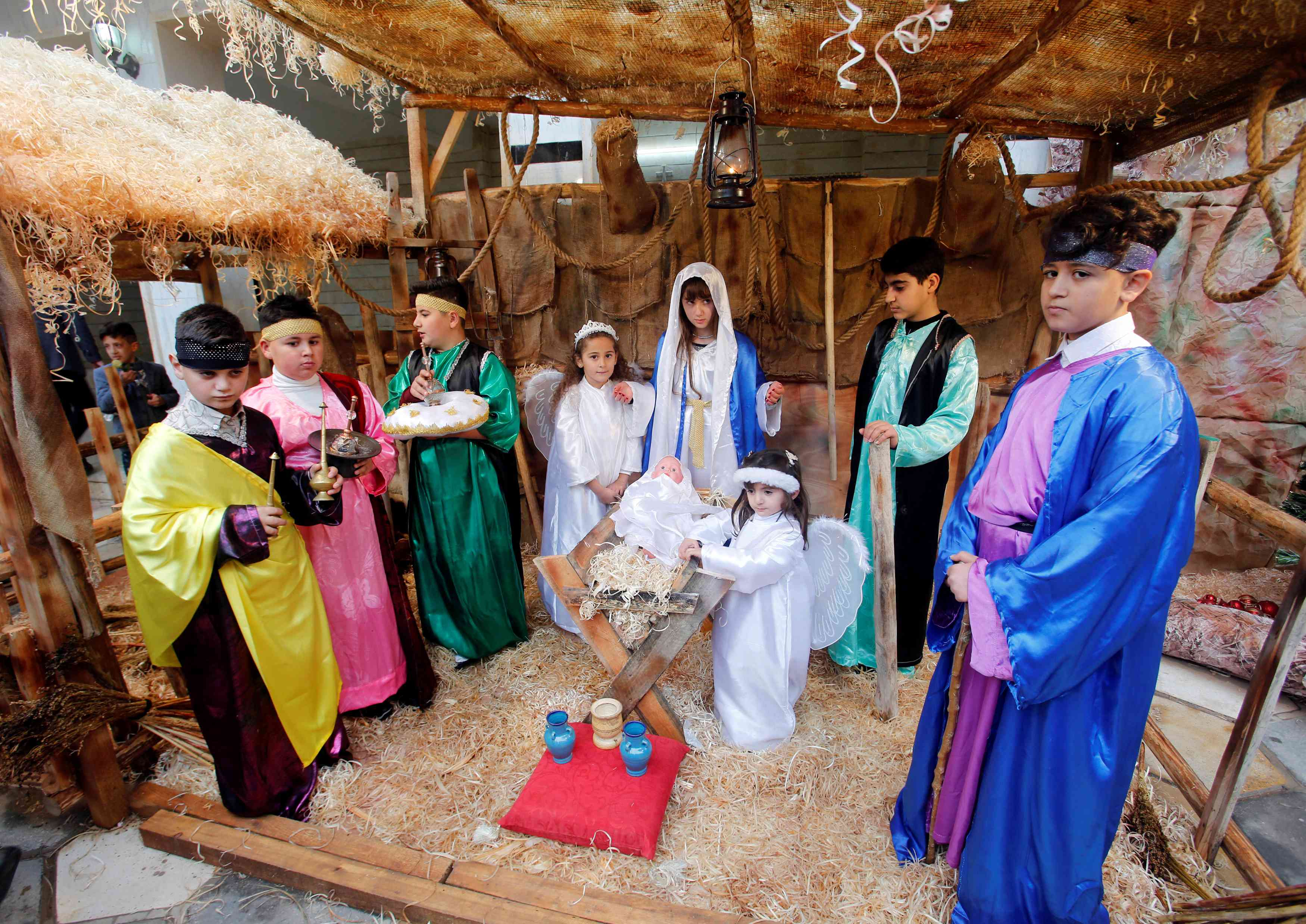 Children participate in a nativity scene in Bashiqa town, east of Mosul, in Iraq on Tuesday. (Photo credit: Khalid al-Mousily/Reuters)