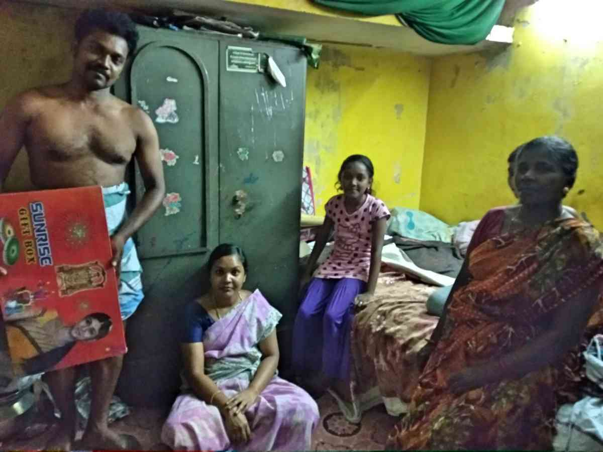 Vasudevan showing his gift of crackers along with his family members in Chennai on Wednesday. (Photo credit: S Senthalir).