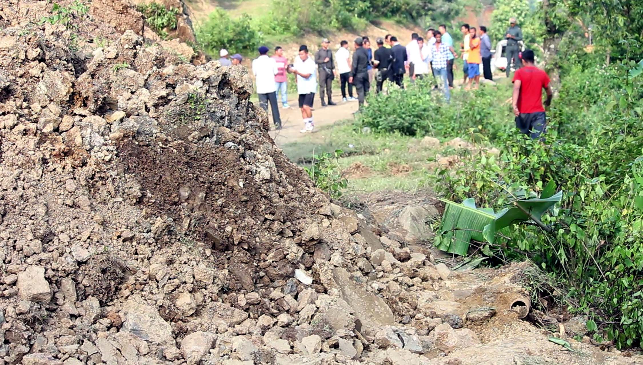 Chunks of earth dislodged by the fissure descend on the Pradhan Mantri Gram Sadak Yojana Road in Kangpokpi district.