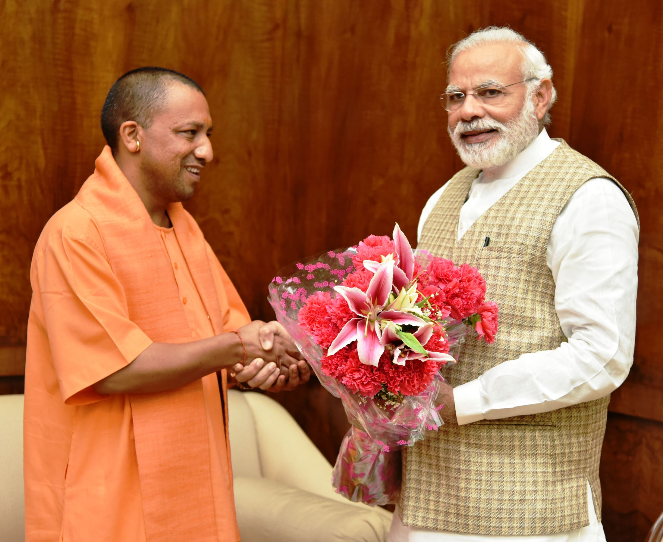Prime Minister Narendra Modi with Uttar Pradesh Chief Minister Adityanath. (Credit: Press Information Bureau)