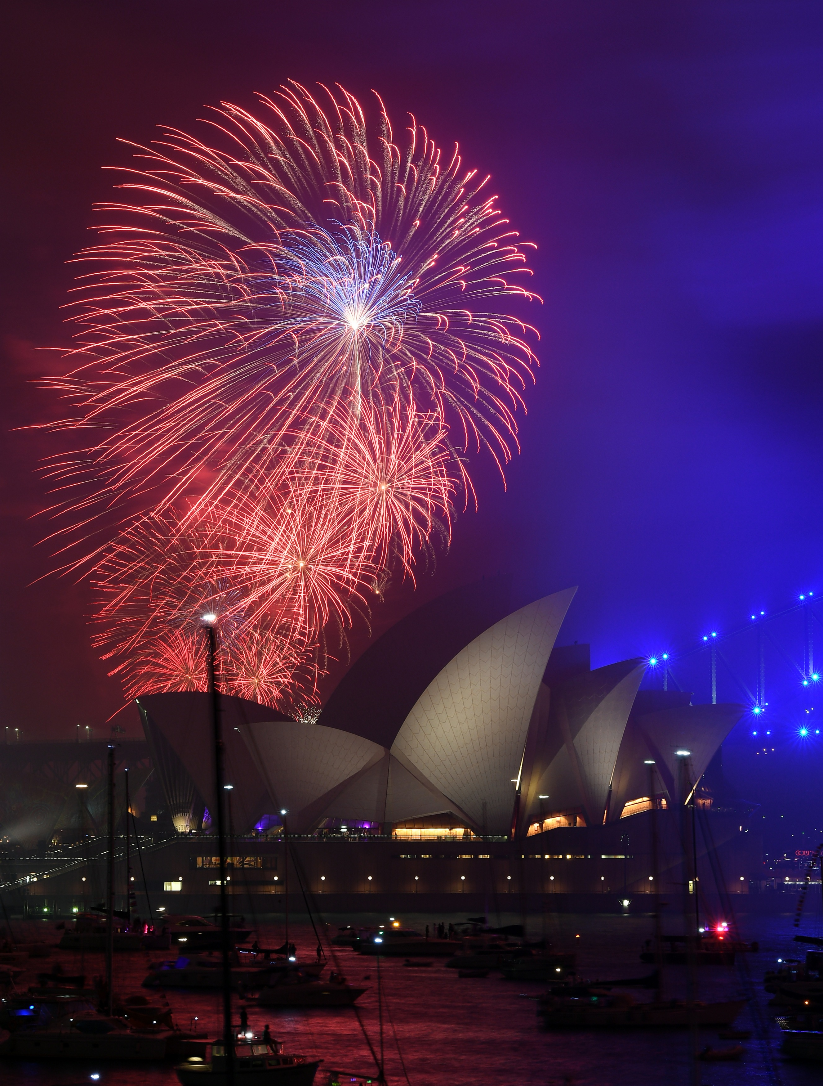 One of the first countries to welcome 2018, fireworks fill the sky over the Opera House in Sydney, Australia. (Image Credit: Saeed Khan/AFP Photo)