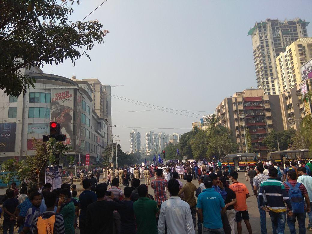 Protestors gather outside Infiniti Mall in Andheri West on Wednesday afternoon. (Niraj Kothari)
