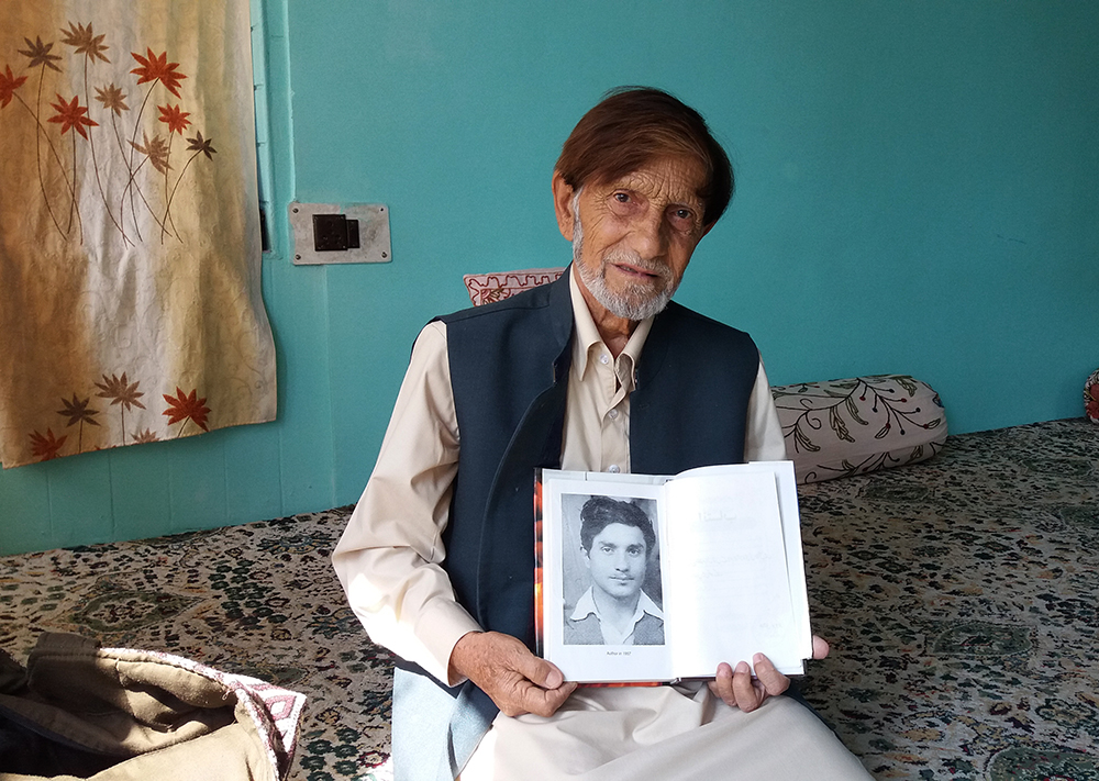 Khaliq Parvez holds up a picture of himself as a young man. Photo credit: Ipsita Chakravatry.