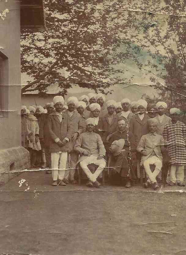 Centre (man holding a hat in his lap): Author's great-grandfather, Madhu Ram Gigoo (1920s, Kashmir)