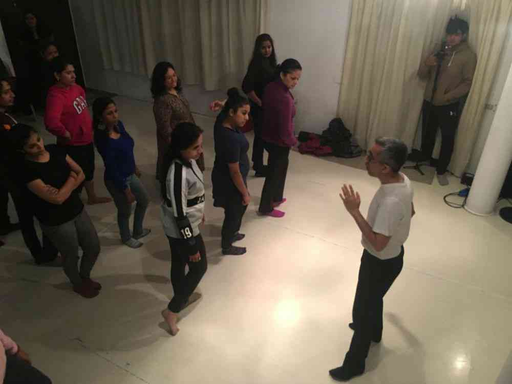 Bhatt teaches a roomful of young kathak artists.