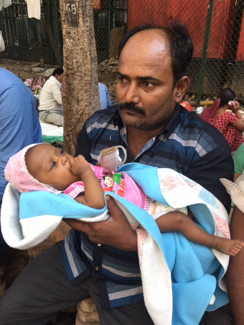 Antop Hill resident, Tayyaz Idrishi with his sick daughter. Photo: Priyanka Vora.