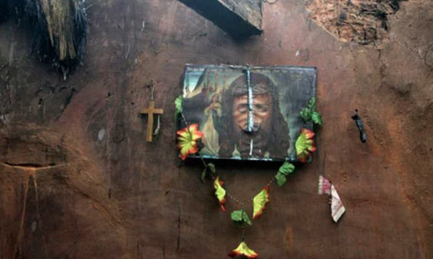 A defaced portrait of Jesus hangs on the wall of a home in Kandhamal on August 30, 2008. (Credit: Parth Sanyal / Reuters)