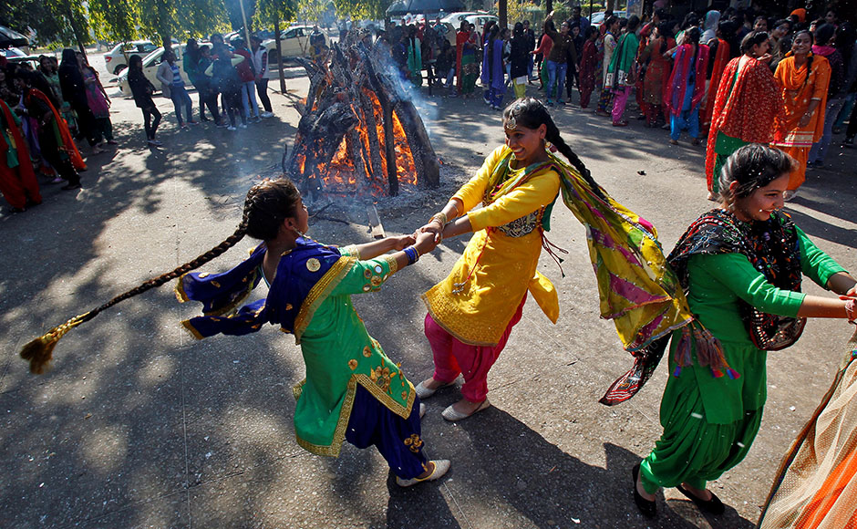 In Punjabi folk tradition, Dulla Bhatti's role in rescuing innocent girls from lecherous men is enshrined in folk poetry that is sung during the winter festival of Lohri. (Credit: Ajay Verma / Reuters)