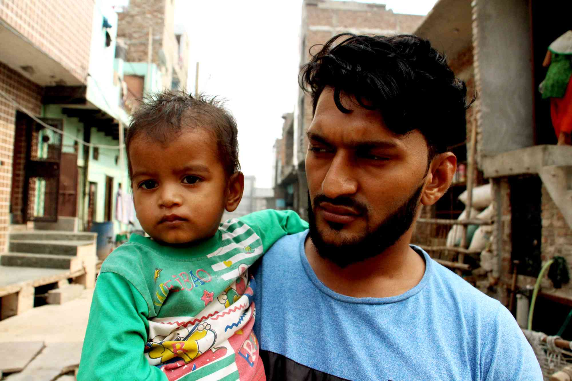 Pravin Kumar with his son. This time last year, his son was in hospital due to difficulty in breathing.