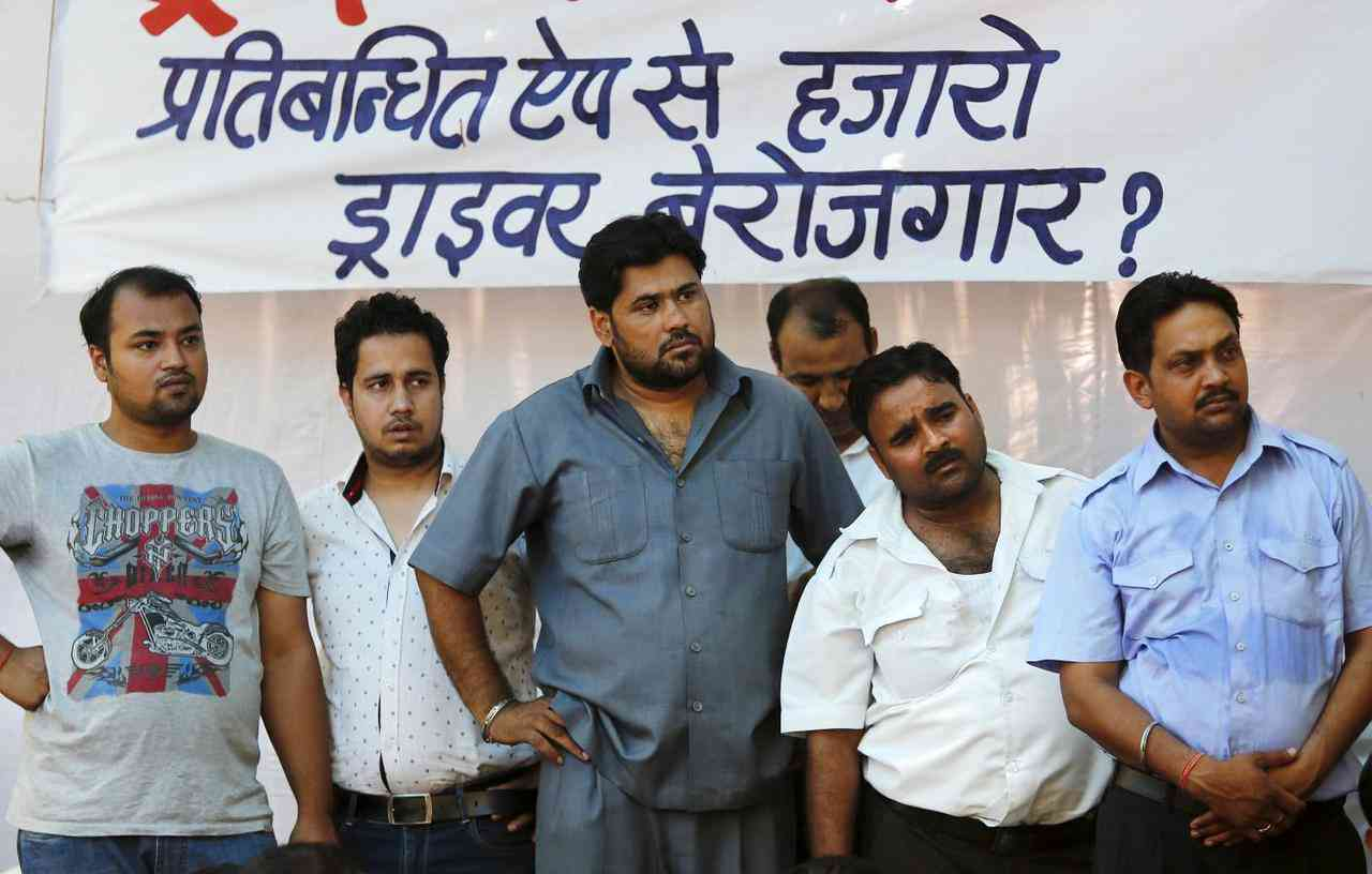 Taxi drivers at meeting in New Delhi listen to a speech about the potential challenges of working with aggregators such as Ola and Uber. Credit: Adnan Abidi/Reuters