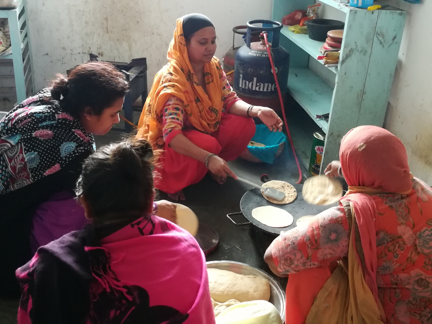 Women make chapatis at the community kitchen in the gurdwara.