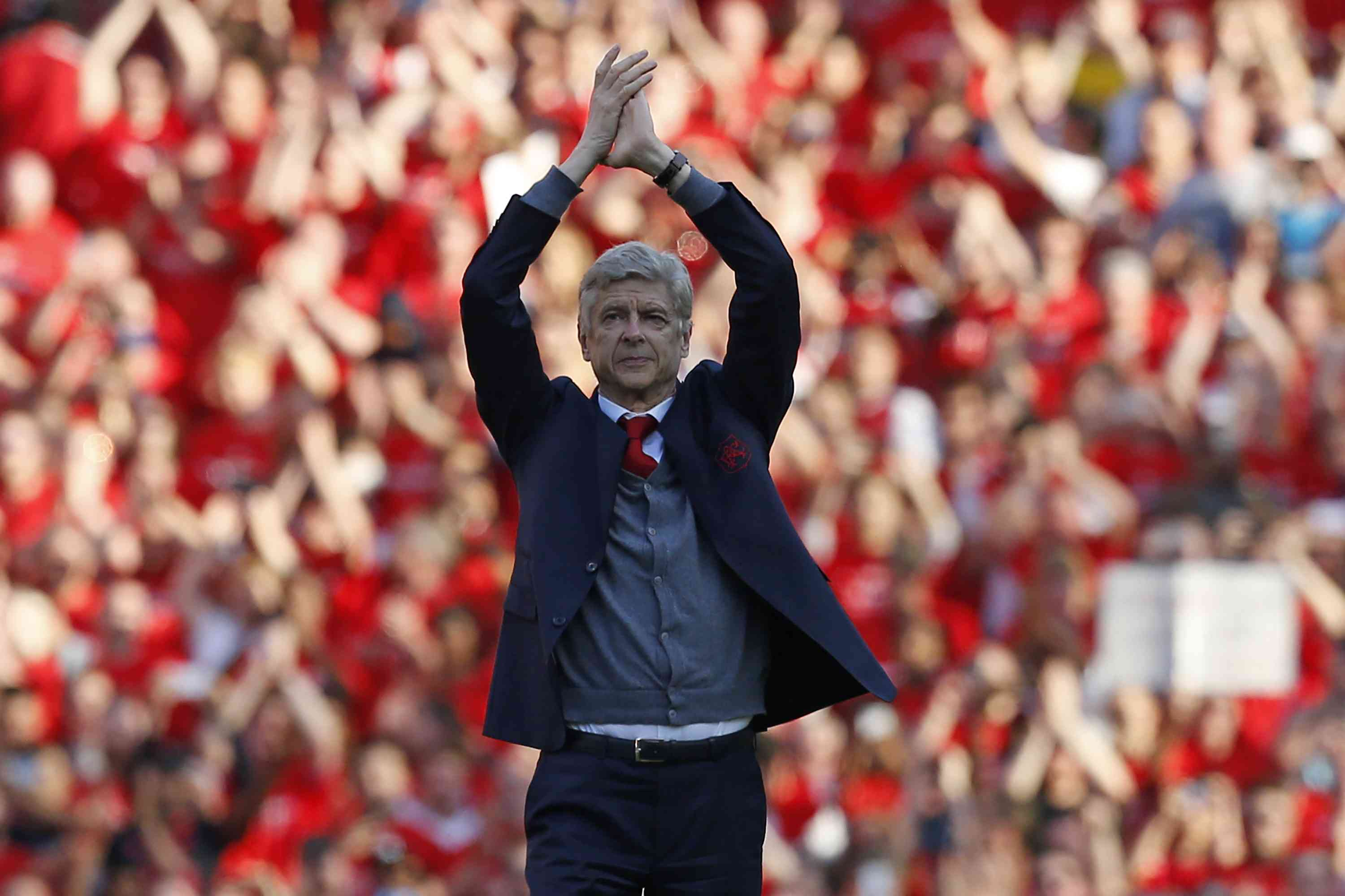 Former Arsenal manager Arsene Wenger bids farewell to the club's supporters after his last match in charge (AFP)