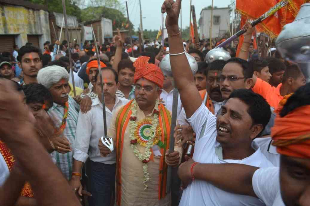 Kharagpur: West Bengal BJP chief Dilip Ghosh leads a Ram Navmi procession holding a sword in Kharagpur on April 5, 2017. (Photo: IANS)