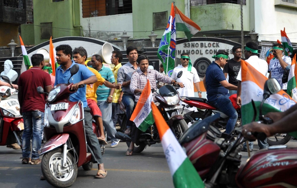 Members of the ruling Trinamool Congress hold a rally in Kolkata on Ram Navami, on March 25. (Photo Credit: IANS).