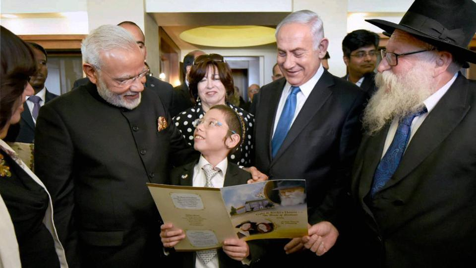 Narendra Modi flanked by Benjamin Netanyahu meet with Moshe Holtzberg in July at the King David Hotel in Jerusalem. Credit: PTI.
