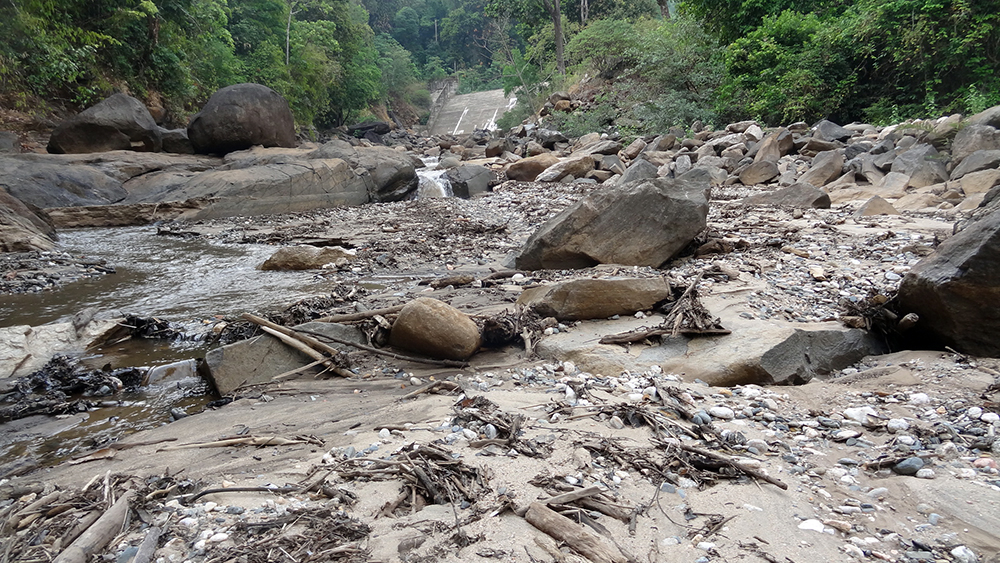 The forests and bed of a stream littered with rubble and boulders after construction. Photo credit: Shishir Rao