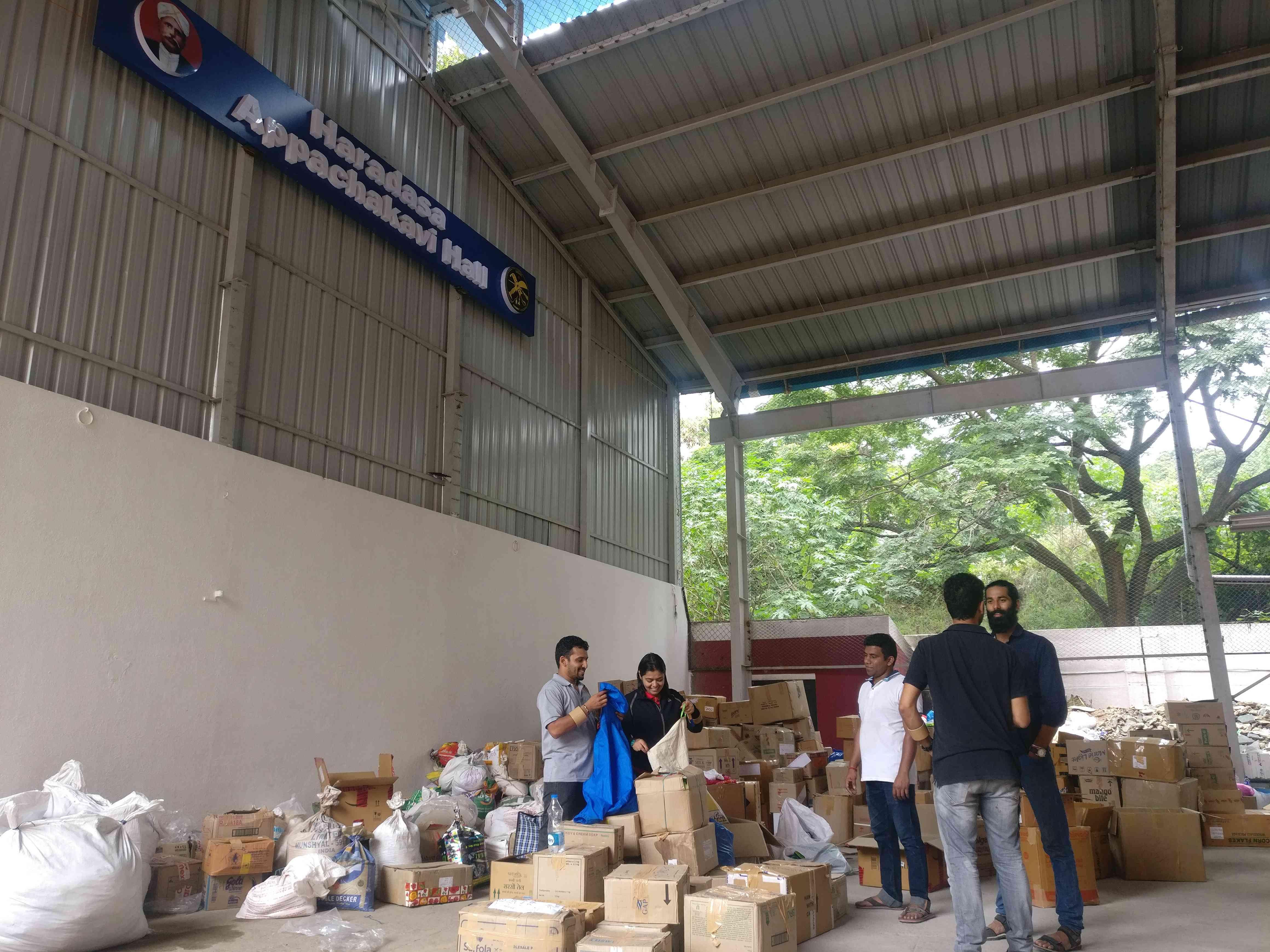 Volunteers collect relief material at the Kodava Samaj in Bengaluru. (Credit: Nayantara Narayanan)