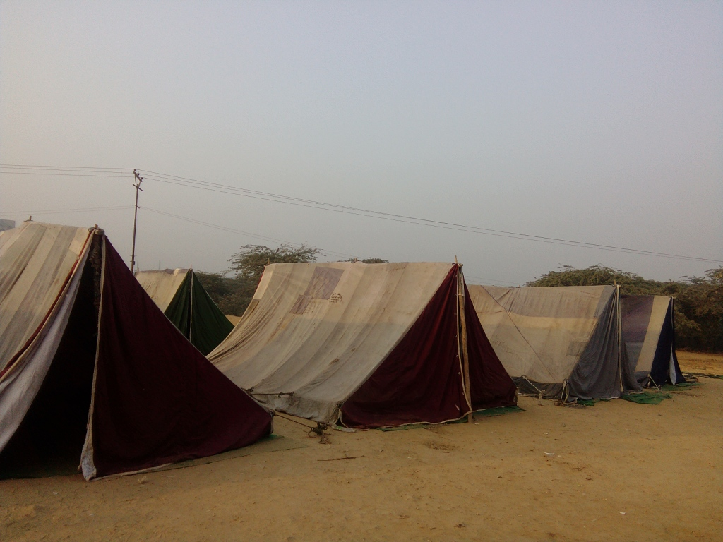 Tents set up by the district administration vacated by the residents of the slum. Photo: Abhishek Dey