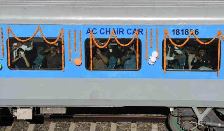 Modi flagging off the first passenger train passing through the Bogibeel Bridge in Assam. Photo Credit: PIB