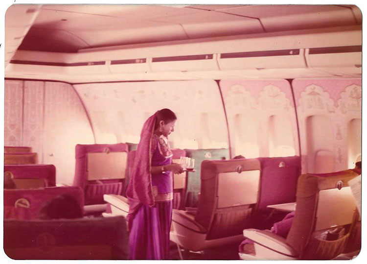 Chikliwala serving VIP passengers in a traditional Rajasthani dress in the 1970s.