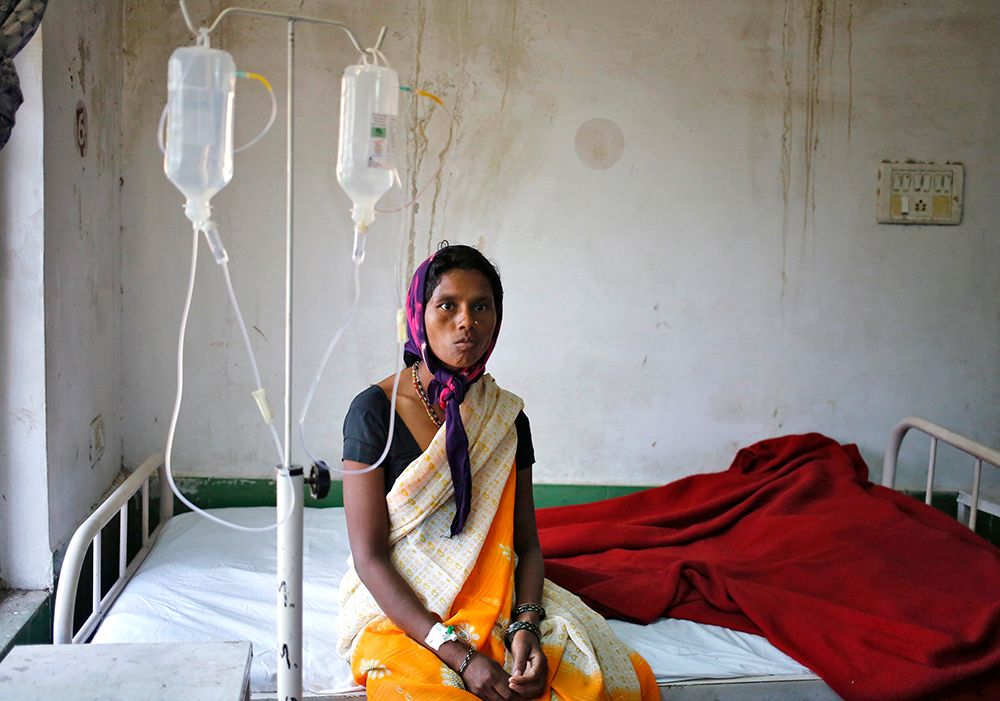 A woman in a hospital in Chattisgarh. Credit: Anindito Mukherjee/Reuters