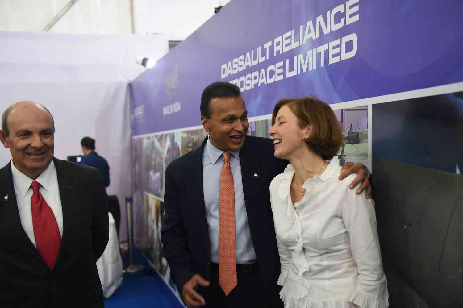 Chairman and CEO of Dassault Aviation Eric Trappier (left), French Defence Minister Florence Parly (right) and chairman of Reliance Group Anil Ambani in Nagpur on October 27, 2017, where they participated in the foundation stone laying ceremony of Dassault Reliance Aerospace Limited. (Photo credit: Money Sharma/AFP).
