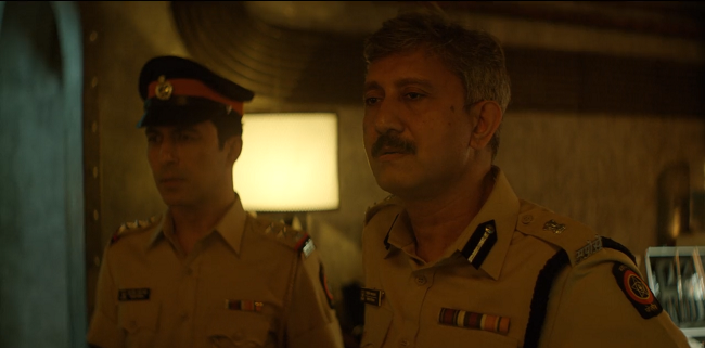 Aamir Bashir as Majid Khan and Neeraj Kabi as DCP Parulkar. Credit: Netflix.