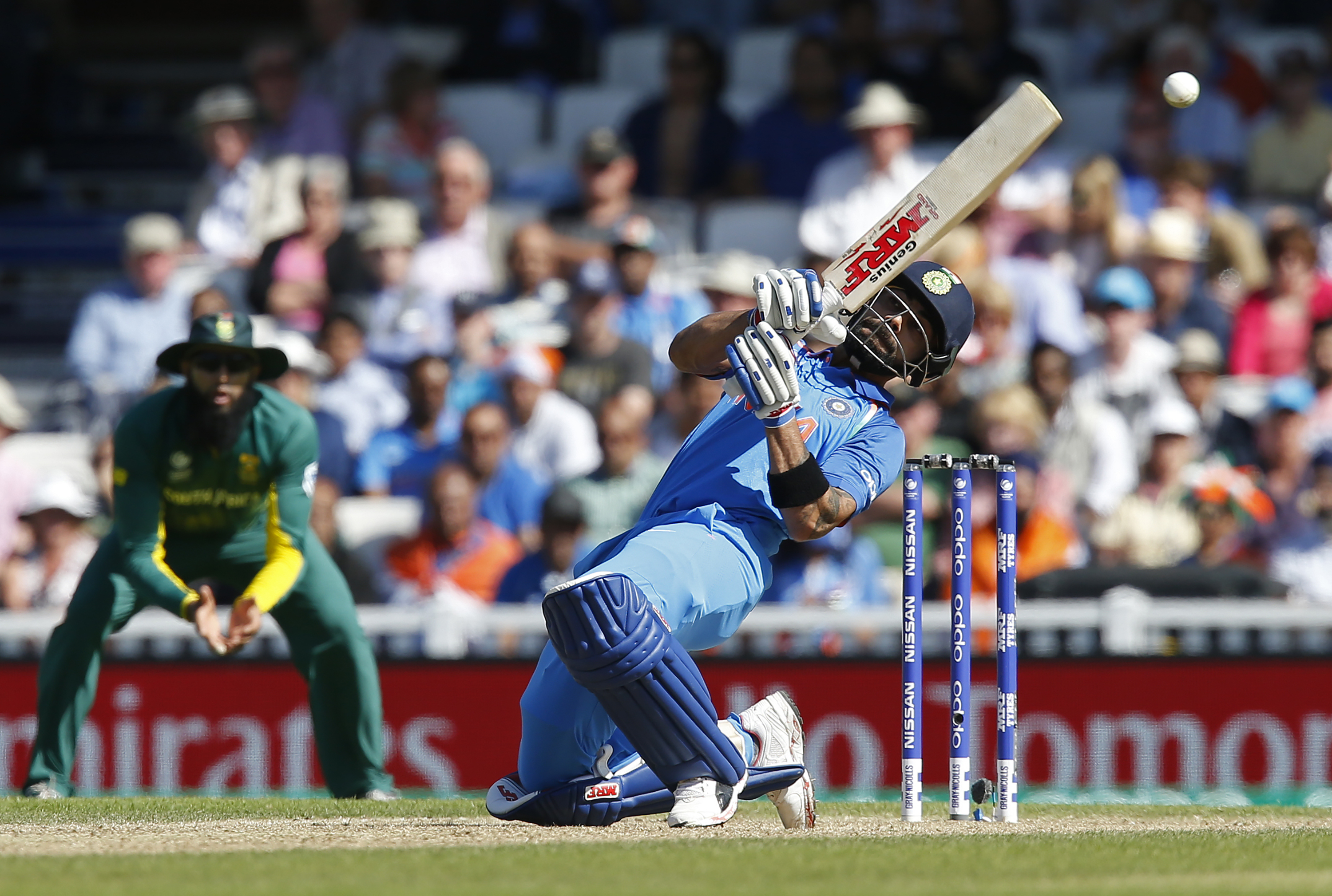 Virat Kohli had come into bat with India on 23/1. His stand with Dhawan proved vital. Photo: AFP