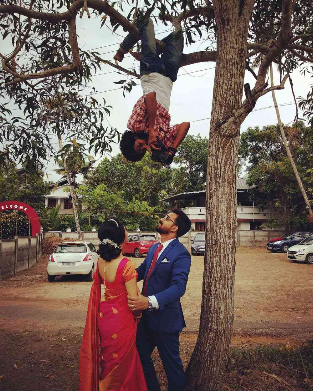 Vishnu hanging upside down to take a photo. Photo credit: Vishnu.