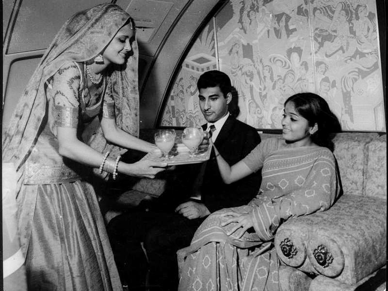 A flight attendant serving passengers in Emperor Ashoka's lounge in 1971.