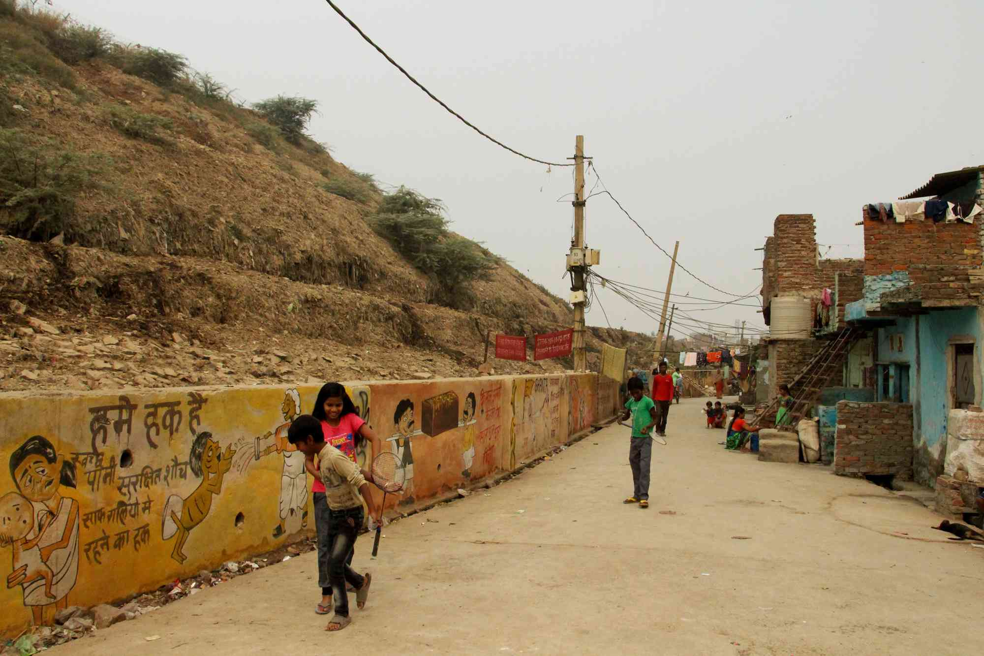 Children play in the lanes below the landfill.