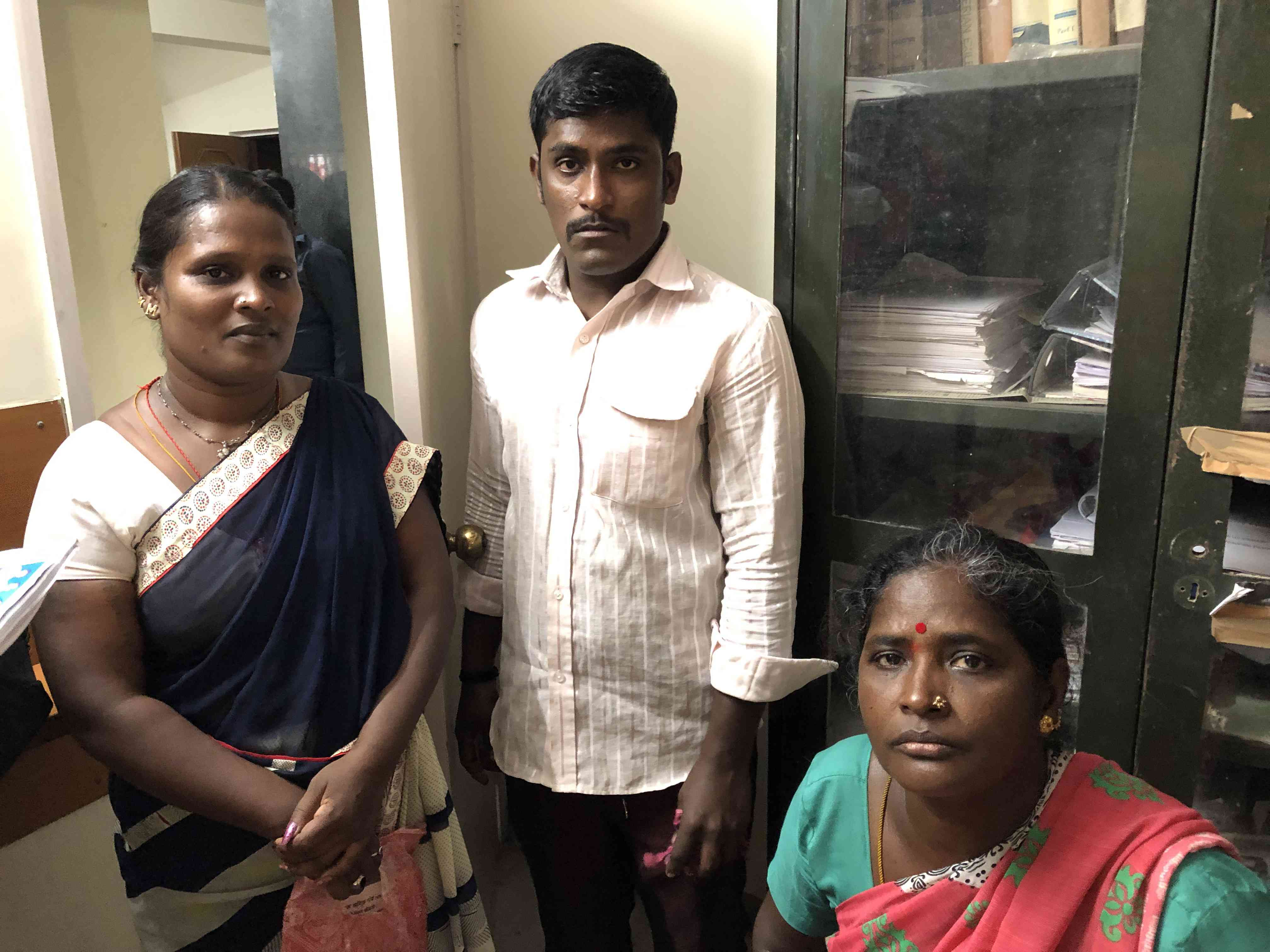 Sanitation workers Vijaya Murghan Perumal Somi (left) and Rane Rajudevendra (right) with a colleague at the Kachra Vahtuk Shramik Sangh union office in December. (Photo credit: Sujatha Fernandes).