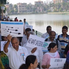 Why Delhi residents are skipping work to save a dying lake