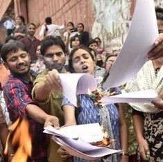 JNU students burn panel report, announce indefinite hunger strike