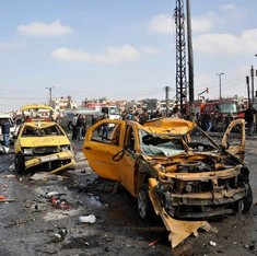 Twin car bombings kill at least 46, wound 100 in Homs, Syria