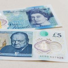 Several UK temples scrap new £5 note that contains animal fat