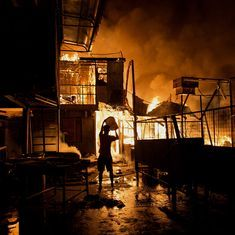 Photos: 15,000 residents rendered homeless near Manila after fire razes shanties to the ground