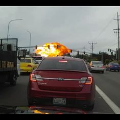 Watch: Plane bursts into flames in mid-air, crashes on a busy road, kills no one, mercifully