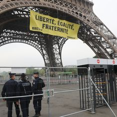 France: Greenpeace activists climb Eiffel Tower to plant banner against Marine Le Pen