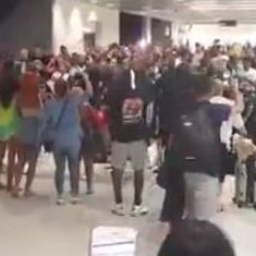 Watch: Passengers and airline staff are scuffling in an airport, and it's not in India