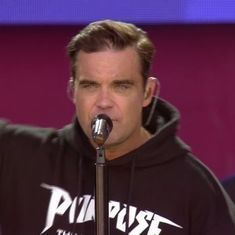 Watch: Robbie Williams breaks down at Manchester concert. The audience joins in to finish the song