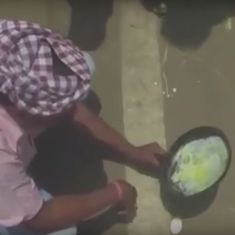 Watch: It's so hot people are cooking (again) on the floor and the road. Who needs a stove?