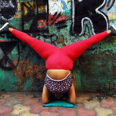Watch: Why this woman is doing headstands on the streets of Mumbai